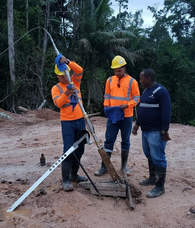 Inserting optical televiewer into borehole with stickup at mining site